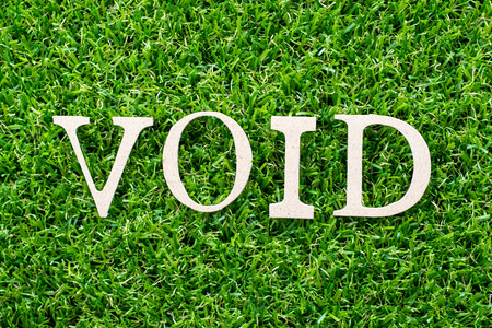 Wood letter in word void on artificial green grass background 写真素材