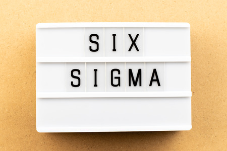 Light box with word six sigma on wood background