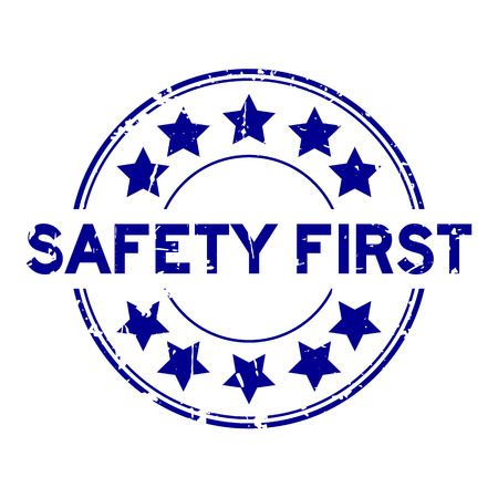 Grunge blue safety first wording with star icon round rubber seal stamp on white background 일러스트