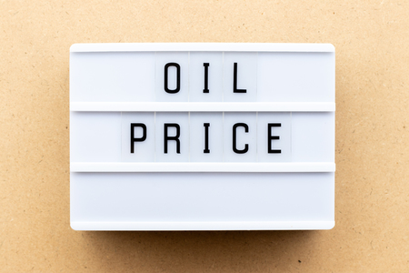 Light box with word oil price on wood background Imagens