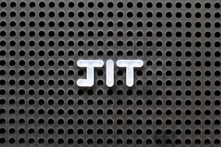Black color pegboard with white letter in word JIT (abbreviation of just in time) Stock Photo