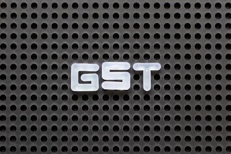 Black color pegboard with white letter in word GST (Abbreviation of Goods and Service Tax) Stock Photo