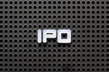 Black color pegboard with white letter in word IPO (Abbreviation of Initial Public Offering)