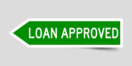 Arrow shape green color sticker in word loan approved on gray background