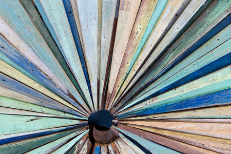 Multi color of old grunge wood panel as radial shape background