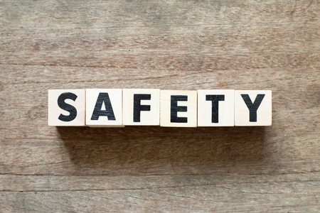 Letter block in word safety on wood background Banco de Imagens - 114500829