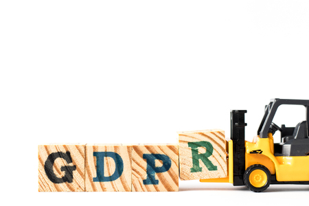 Toy forklift hold letter block r to complete word GDPR (General Data Protection Regulation) on white background