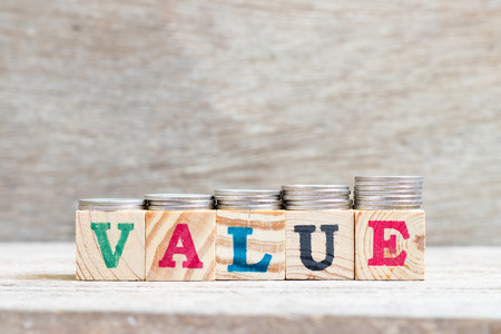 Letter block in word on wood background with coin stack in up trend (Concept for profit, sale, value is growing or business success) Stock Photo - 114641372