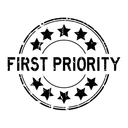 Grunge black first priority word with star icon round rubber seal stamp on white background