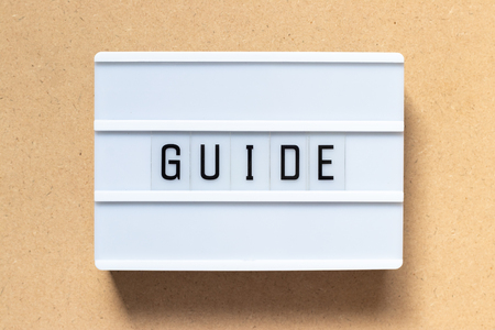 White lightbox with word guide on wood background