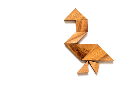 Wood tangram puzzle in walking swan or duck shape on white background Banque d'images - 120890747