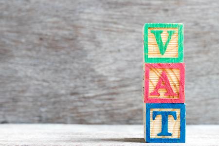 Color letter block in word vat (abbreviation of value added tax) on wood background Reklamní fotografie