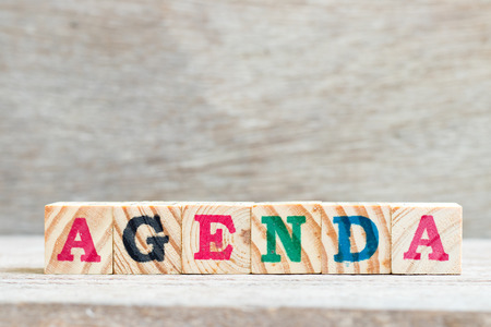 Letter block in word agenda on wood background