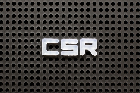Black color pegboard with white letter in word CSR (Abbreviation of corporate social responsibility)