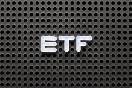 Black color pegboard with white letter in word ETF (abbreviation of Exchange Traded Fund) Stock Photo