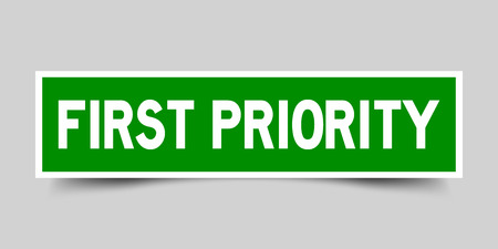 Green color sticker in word first priority on gray background