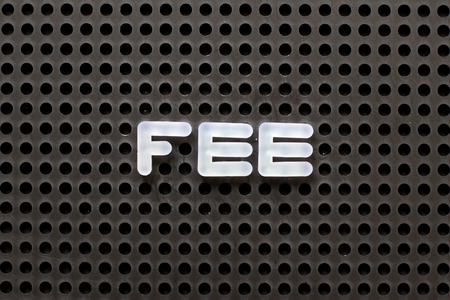 Black color pegboard with white letter in word fee