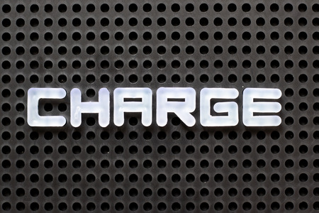 Black color pegboard with white letter in word charge Stock Photo
