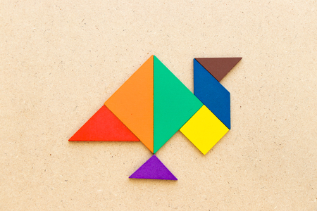 Color tangram in turkey hen or gobbler shape on wood background Stock Photo