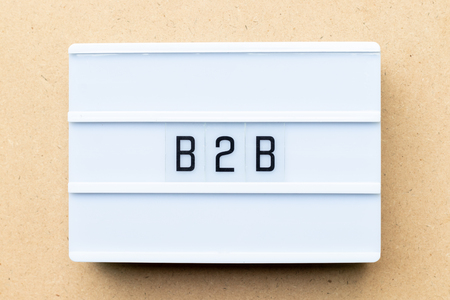 White lightbox with word b2b (abbreviation of business to business) on wood background Stock Photo