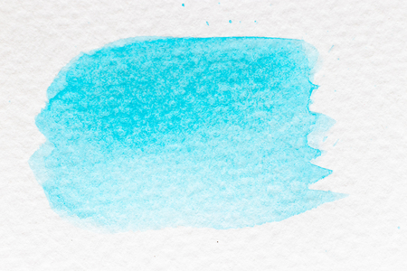 Cyan or light blue color watercolor handdrawing as brush or banner on white paper background