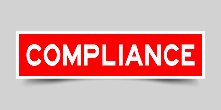 Square red sticker label in word compliance on gray background
