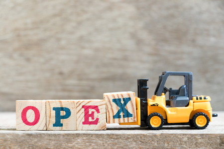 Toy forklift hold letter block x in word opex (abbreviation of operating expense) on wood background