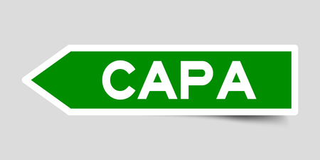 Label sticker in green color arrow shape as word CAPA (abbreviation of corrective action and preventive action) on white background