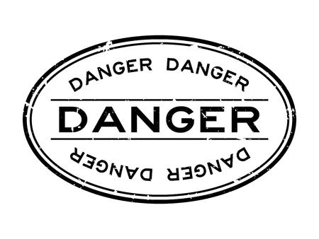 Grunge black danger word oval rubber seal stamp on white background Vetores