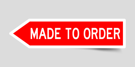 Arrow shape red color label sticker in word made to order on gray background