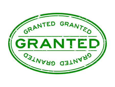 Grunge green granted word oval rubber seal stamp on white background