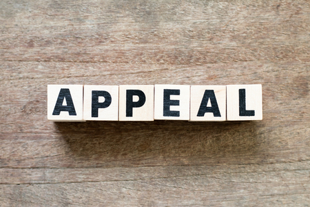 Letter block in word appeal on wood background