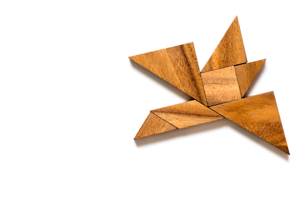 Wood tangram puzzle in flying bird on white background Stock Photo