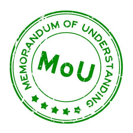 Grunge green MOU (abbreviation of memorandum of understanding) word round rubber seal stamp on white background