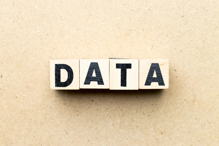 Alphabet letter block in word data on wood background 版權商用圖片