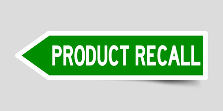 Arrow shape green color sticker in word product recall on gray background