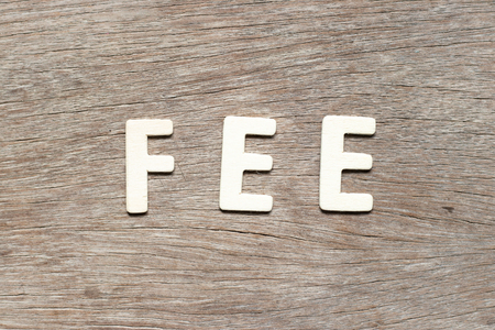 Alphabet letter in word fee on wood background