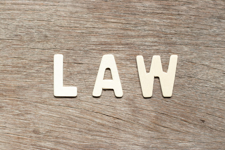 Alphabet letter in word law on wood background