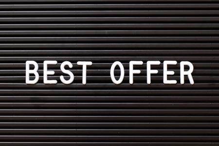 Black color felt letter board with white alphabet in word best offer background