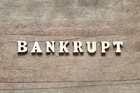 Letter block in word bankrupt on wood background