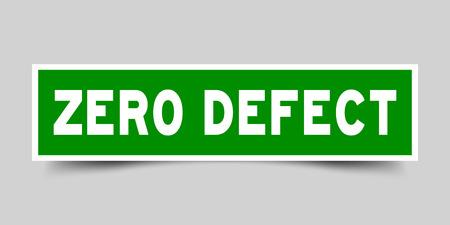 Square green sticker label in word zero defect on gray background