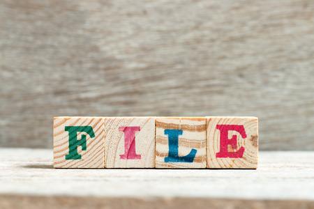 Letter block in word file on wood background Stok Fotoğraf