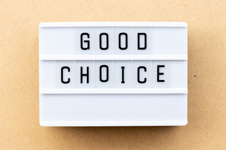 Light box with word good choice on wood background Imagens