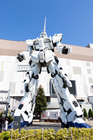 TOKYO, JAPAN - April 28, 2019, The unidentified traveler look at RX-0 Unicorn Gundam statue in normal mode located at Diver City Tokyo Plaza Tokyo, Odaiba