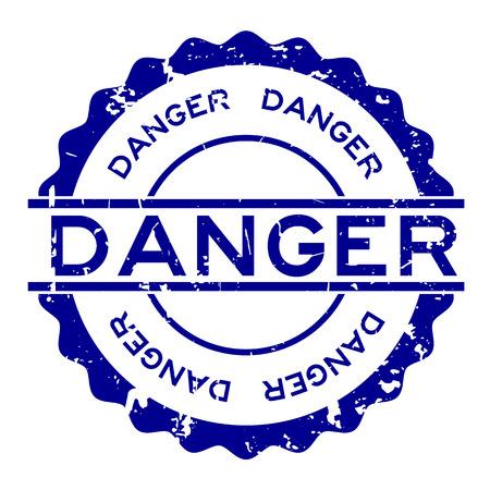Grunge blue danger word round rubber seal stamp on white background