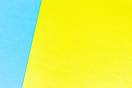 Abstract yellow and light blue color paper textured background with copy space for design and decoration
