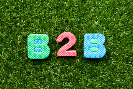 Toy foam letter in word b2b (abbreviation of business to business) on green grass background