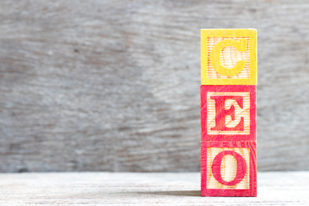 Color letter block in word CEO (Abbreviation of Chief Executive Officer) on wood background Reklamní fotografie