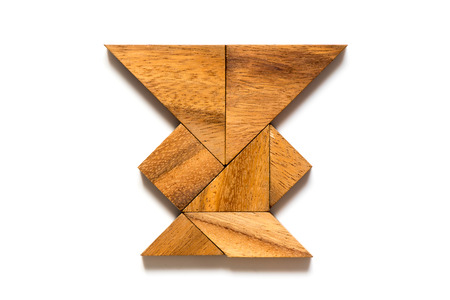 Wood tangram in vase shape on white background