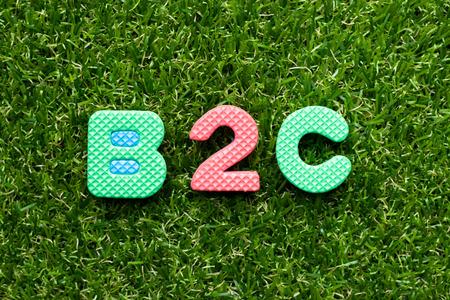 Toy foam letter in word b2c (Abbreviation of business to consumer) on green grass background
